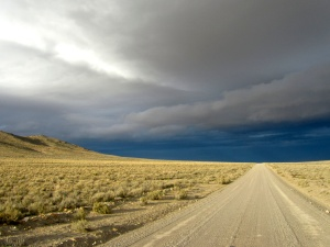 Good gravel road, fantastic high desert country, amazing stormy sky.