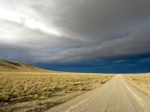 Good gravel road, fantastic high desert country, amazing stormy sky.