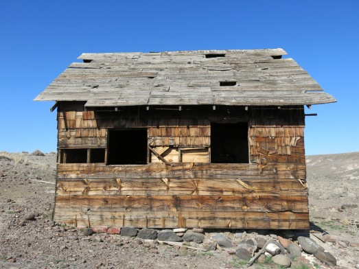 Rock foundation and cedar shakes