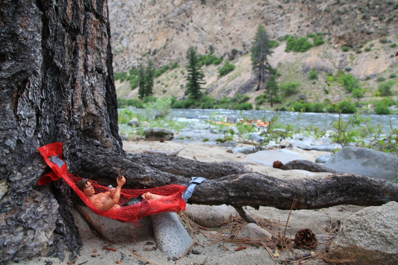 River trips can be a lot of work. Take time each day to relax with a good book and a cold beer.