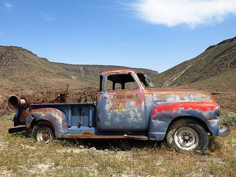 The canyon has several old mines. This truck is perched  on a flat spot above a mine on the canyon's edge.