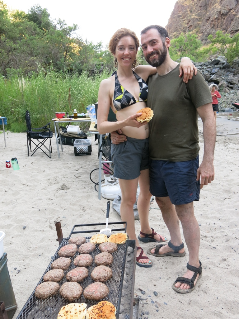 Noelle and Lawrence serve up burgers and smiles.